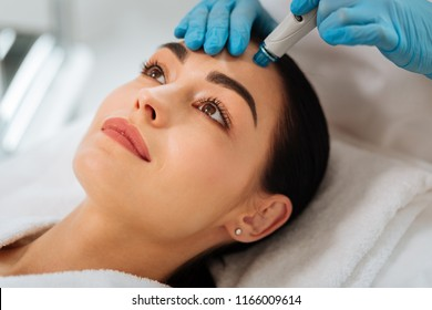 Hydrafacial procedure. Close up of a face of a nice beautiful woman during hydrafacial procedure