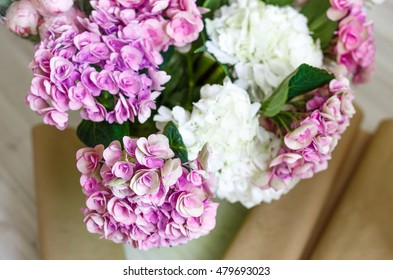hydrangea flowers in bucket at workshop close up