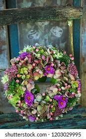 Hydrangea wreath on a old garden chair