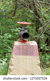 Hydrant Valve with Socket on top of a Trapezoid shaped concrete block-Vertical Image