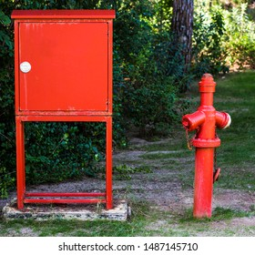 Hydrant with water hoses and fire extinguisher equipment in outdoors (park, garden, forest, hotel)