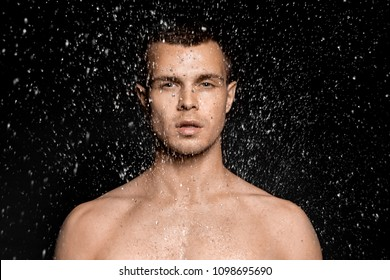 Hydrated male portrait in water splash and drops