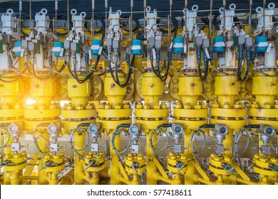 Hydraulic choke or throttle valves ninety degree angle valve type at oil and gas wellhead remote platform with pressure transmitter to monitor downstream pressure, energy business at offshore.