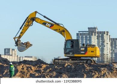 Hydraulic Crawler Excavator Cat working at a ground. Russia. Saint-Petersburg. 16 January 2018