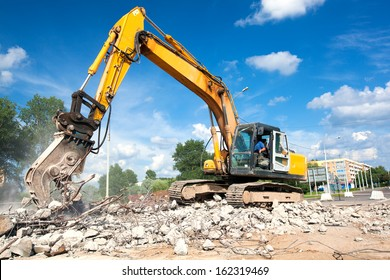 Hydraulic Crusher excavator machine at Site Demolition