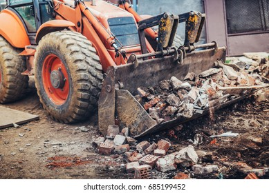 Hydraulic crusher, industrial excavator machinery working on construction site demolition