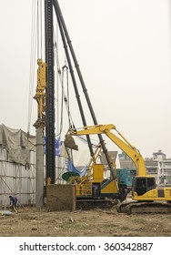 Hydraulic drilling machine for bored pile foundation at construction site.