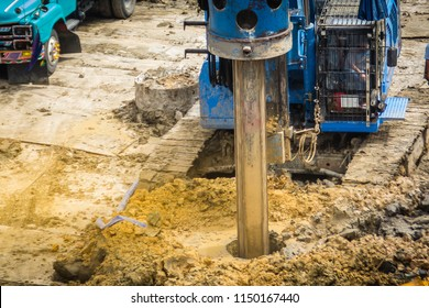 Hydraulic drilling machine is boring holes in the construction site for bored piles work. Bored piles are reinforced concrete elements cast into drilled holes, also known as replacement piles.
