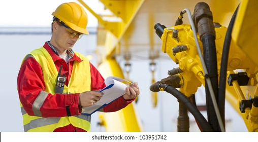Hydraulic engineer doing a safety check on a new installation