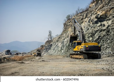 Hydraulic Excavator or track backhoe in operations. Working in mining industry. Mining activities. Mine operations. Quarry Operations.