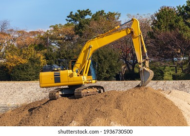 Hydraulic excavator working on a sand pile