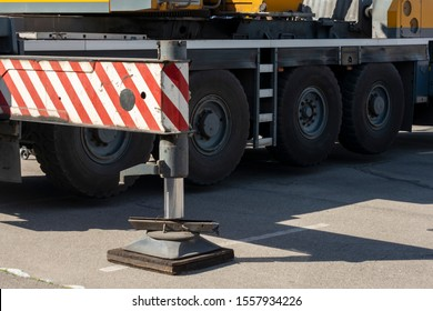 Hydraulic foot of the crane. Extended side truck outrigger stabilizer. Support to mobile telescopic crane. close-up.