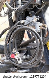 Hydraulic hoses on a technical device
