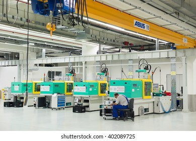 Injection Molding Machine Images, Stock Photos & Vectors