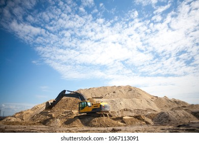 hydraulic iron large diesel mechanical excavator digging earth machine at excavation earthmoving work in sand quarry