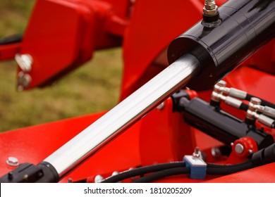 Hydraulic mechanism on modern machine. Industrial detail piston in machinery. Technology.