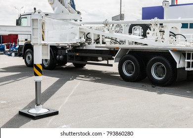 hydraulic outriggers of the crane installed on the truck. different parts of Construction machinery
