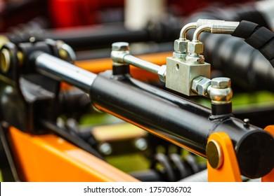 Hydraulic system on modern heavy machine. Industrial detail piston in machinery. Technology.