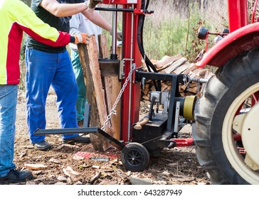 Hydraulic wood splitter at tractor machine in forest