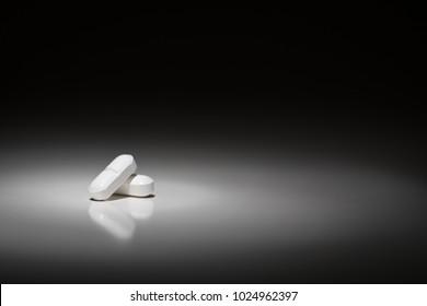 Hydrocodone Prescription Pills Under Spot Light.