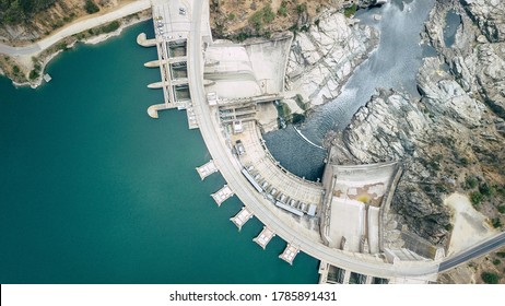 Hydroelectric power energy plant with turbines and water spills for generating green electricity. Free, green adn ecological energy concept. Climate changes