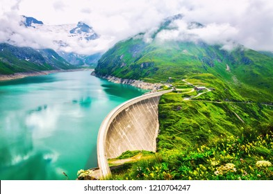 Hydroelectric power station at high mountains in clouds. Kaprun dam.