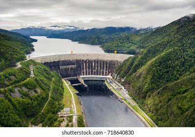 Hydroelectric power station on the Yenisei River in Siberia. Sayano-Shushenskaya Dam from aerial view