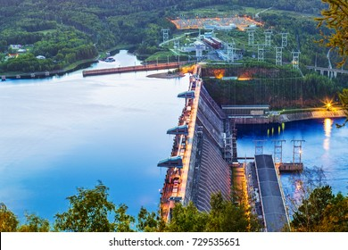 Hydroelectric power station on the Yenisei River in Siberia near Krasnoyarsk in the glow of the sunrise
