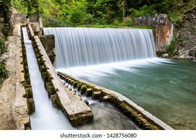 Hydroelectric waterfall and fish lader in a river