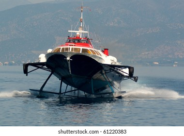 A hydrofoil approaching the port of the greek island Hydra.