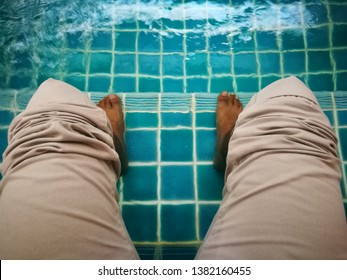Hydrotherapy is treatment of musculoskeletal diseases with soak leg in a warm water in tub (blurred image from motion water)