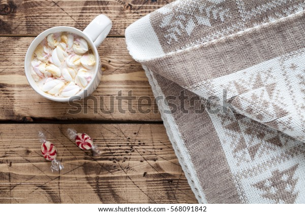 Hygge  concept - cup of hot cocoa with marshmallow on wood background, top view