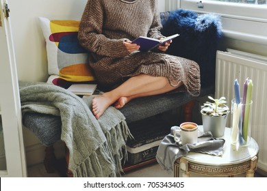 Hygge home interior. Cozy home and cup of coffee