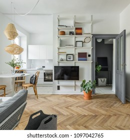 Hygge home interior with wooden floor, tv and bookcase
