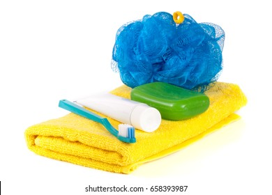 Hygiene products: soap, toothbrush and paste, loofah, towel isolated on white background