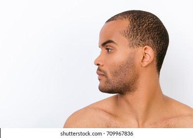 Hygiene, vitality, beauty, men life concept. Side profile view of afro young nude guy with stubble isolated on pure background, copy space near