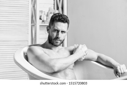 Hygienic procedure concept. Total relaxation. Bathing can improve heart health. Personal hygiene. Take care hygiene. Cleaning parts body. Hygiene concept. Man muscular torso sit in bathtub. Skin care.