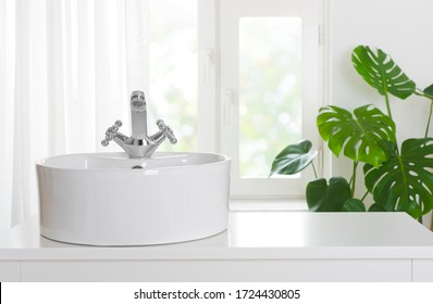 Hygienic wash basin with chrome faucet on bathroom window background - Shutterstock ID 1724430805