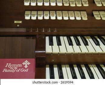 Hymnal resting beside a church organ.