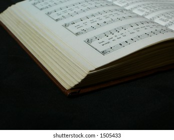 Hymnbook Opened to Reveal Music