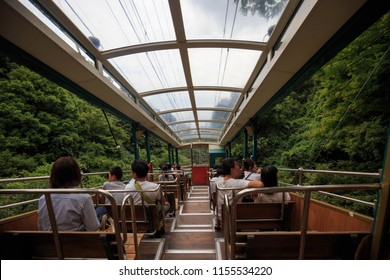 Hyogo, Japan - August 8, 2018: Rokko Cable car transports passengers up mountain overlooking Kobe and Osaka Bay