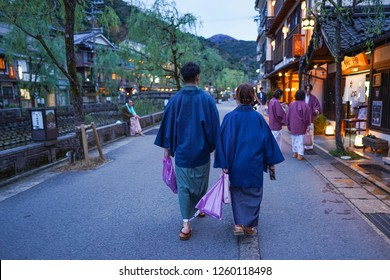 Hyogo - Nov. 16, 2018: Japanese couple wearing yukata is seen walking at Kinosaki Onsen