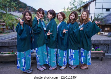 Hyogo - Nov. 16, 2018: Japanese woman wearing yukata posing for photo at Kinosaki Onsen