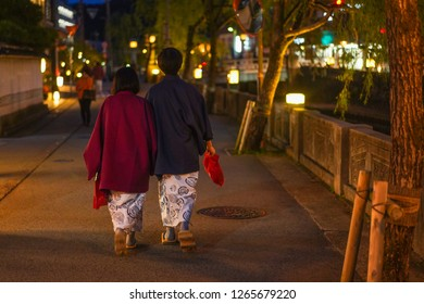Hyogo - Nov. 16, 2018: Japanese couple wearing walking in street at Kinosaki Onsen (Noise Visible)