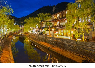 Hyogo - Nov. 16, 2018: Peaceful view of main street of Kinosaki Onsen at dusk (Noise Visible)