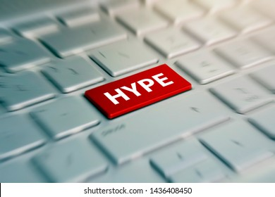 HYPE - red Button on grey Computer Keyboard. blurred in motion background.