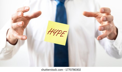 Hype time concept. hype word on yellow note paper between hands of businessman, catching hype