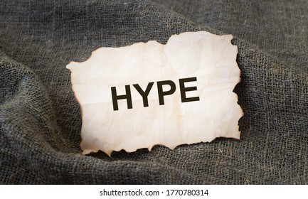 Hype time concept. hype word on old paper on natural linen cloth. ecology hype concept