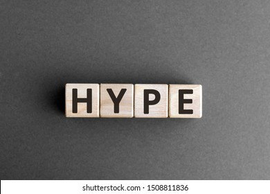 Hype - wooden blocks with letters, make people excited media hype concept,  top view on grey background