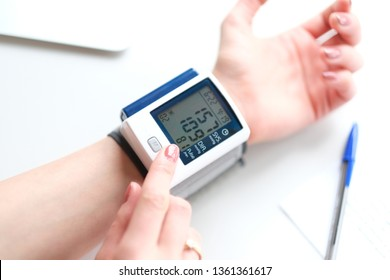 Hypertension. Patient measuring blood pressure.